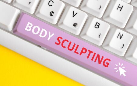Writing note showing Body Sculpting. Business concept for activity of increasing the body s is visible muscle tone White pc keyboard with note paper above the white background Фото со стока - 130024239