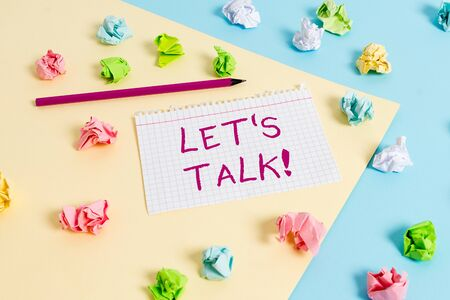 Text sign showing Let S Is Talk. Business photo text suggesting in the beginning of a conversation on the topic Colored crumpled papers empty reminder blue yellow background clothespin