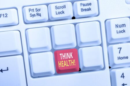 Conceptual hand writing showing Think Health. Concept meaning state of complete physical mental and social well being White pc keyboard with note paper above the white background