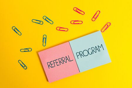 Writing note showing Referral Program. Business concept for employees are rewarded for introducing suitable recruits Colored square blank sticky notepads sheets clips color background Stock Photo
