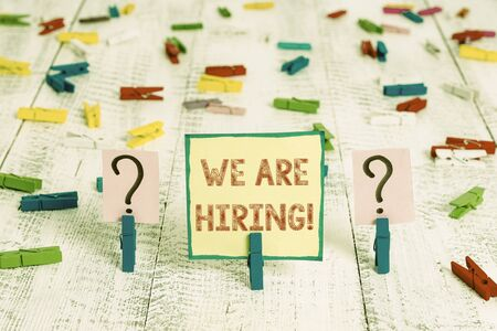 Handwriting text We Are Hiring. Conceptual photo recently you employ someone or pay someone to do particular job Scribbled and crumbling sheet with paper clips placed on the wooden table