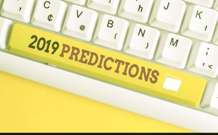 Text sign showing 2019 Predictions. Business photo text statement about what you think will happen in 2019 White pc keyboard with empty note paper above white background key copy space Reklamní fotografie