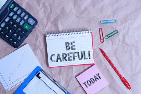 Writing note showing Be Careful. Business concept for making sure of avoiding potential danger mishap or harm Papercraft desk square spiral notebook office study supplies