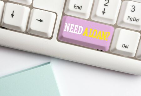 Word writing text Need A Loan Question. Business photo showcasing asking he need money expected paid back with interest White pc keyboard with empty note paper above white background key copy space