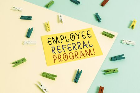 Text sign showing Employee Referral Program. Business photo text internal recruitment method employed by organizations Colored clothespin paper empty reminder yellow blue floor background office