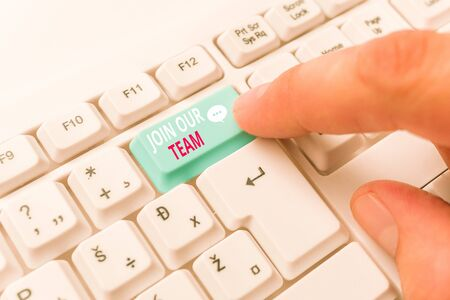Writing note showing Join Our Team. Business concept for inviting someone to join in your local group or company White pc keyboard with note paper above the white background 写真素材