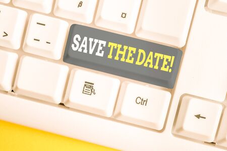 Word writing text Save The Date. Business photo showcasing remember not schedule anything else on this day White pc keyboard with empty note paper above white background key copy space 版權商用圖片