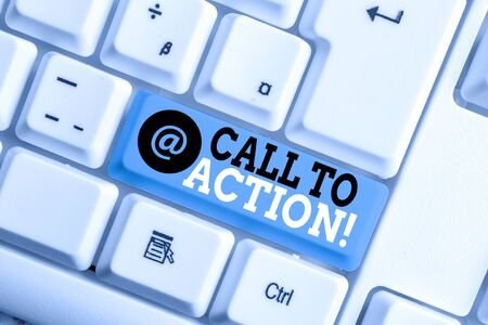 Text sign showing Call To Action. Business photo showcasing exhortation do something in order achieve aim with problem White pc keyboard with empty note paper above white background key copy space 写真素材