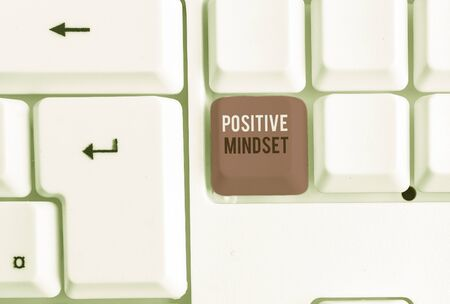Conceptual hand writing showing Positive Mindset. Concept meaning mental attitude in wich you expect favorable results White pc keyboard with note paper above the white background Stock fotó