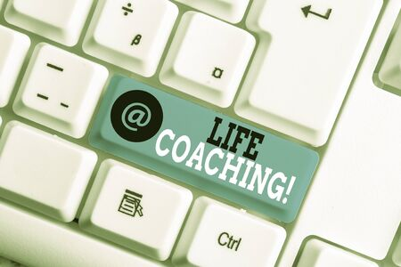 Text sign showing Life Coaching. Business photo showcasing demonstrating employed to help showing attain their goals in career White pc keyboard with empty note paper above white background key copy space Stock fotó