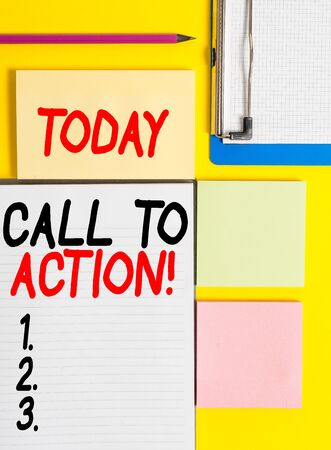 Conceptual hand writing showing Call To Action. Concept meaning exhortation do something in order achieve aim with problem Empty papers with copy space on yellow background table