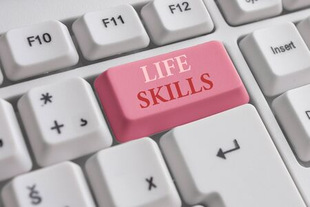 Text sign showing Life Skills. Business photo text skill that is necessary for full participation in everyday life White pc keyboard with empty note paper above white background key copy space Foto de archivo