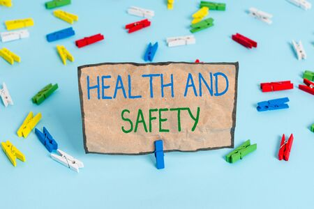 Handwriting text writing Health And Safety. Conceptual photo procedures intended to prevent accident in workplace Colored clothespin papers empty reminder blue floor background office pin