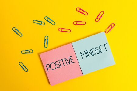 Writing note showing Positive Mindset. Business concept for mental attitude in wich you expect favorable results Colored square blank sticky notepads sheets clips color background