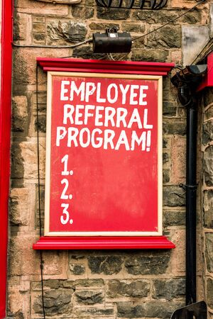 Conceptual hand writing showing Employee Referral Program. Concept meaning internal recruitment method employed by organizations Blank board copy space for commercial advertising on wall