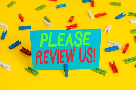 Writing note showing Please Review Us. Business concept for situation or system is formal examination by showing authority Colored clothespin papers empty reminder yellow floor background office