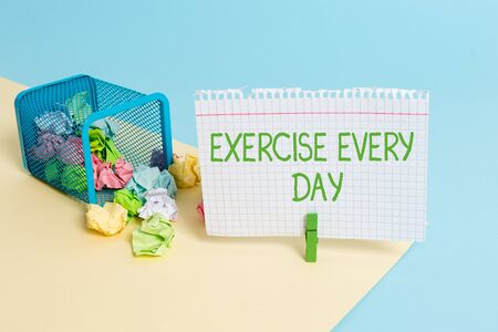 Text sign showing Exercise Every Day. Business photo text move body energetically in order to get fit and healthy Trash bin crumpled paper clothespin empty reminder office supplies tipped