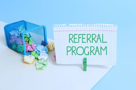 Text sign showing Referral Program. Business photo text employees are rewarded for introducing suitable recruits Trash bin crumpled paper clothespin empty reminder office supplies tipped