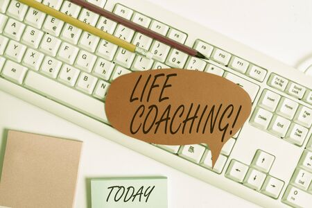 Word writing text Life Coaching. Business photo showcasing demonstrating employed to help showing attain their goals in career Empty copy space red note paper bubble above pc keyboard for text message Stock fotó