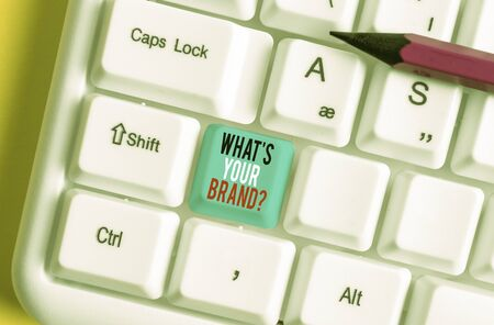 Conceptual hand writing showing What S Your Brand Question. Concept meaning asking about product logo does or what you communicate White pc keyboard with note paper above the white background