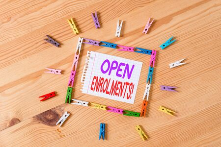 Handwriting text writing Open Enrolments. Conceptual photo when employees may make changes to elected fringe benefit Colored clothespin papers empty reminder wooden floor background office