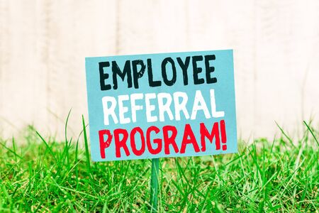 Handwriting text Employee Referral Program. Conceptual photo internal recruitment method employed by organizations Plain empty paper attached to a stick and placed in the green grassy land