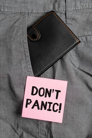 Conceptual hand writing showing Don T Panic. Concept meaning suddenly feel so worried or frightened that you can not behave Small wallet inside trouser front pocket near notation paper Stock fotó
