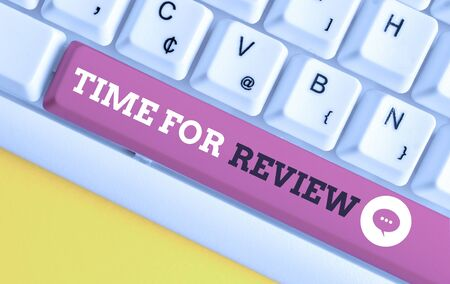 Writing note showing Time For Review. Business concept for review of a system or situation in its formal examination White pc keyboard with note paper above the white background