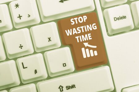 Text sign showing Stop Wasting Time. Business photo text advising demonstrating or group start planning and use it White pc keyboard with empty note paper above white background key copy space