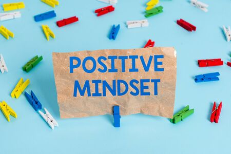 Text sign showing Positive Mindset. Business photo text mental attitude in wich you expect favorable results Colored clothespin papers empty reminder blue floor background office pin Stock fotó