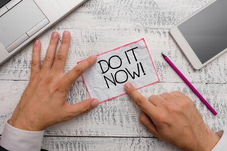Conceptual hand writing showing Do It Now. Concept meaning not hesitate and start working or doing stuff right away