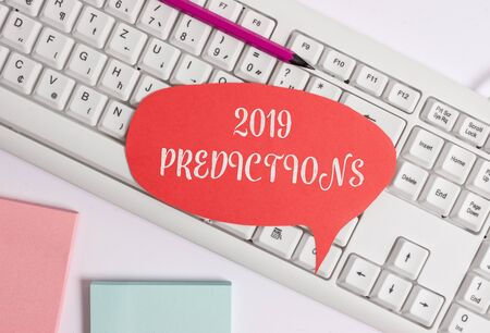 Writing note showing 2019 Predictions. Business concept for statement about what you think will happen in 2019 Empty copy space red note paper above pc keyboard for text message