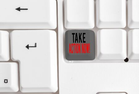Text sign showing Take Action Now. Business photo text do something official or concerted achieve aim with problem White pc keyboard with empty note paper above white background key copy space