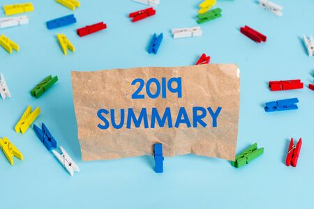 Text sign showing 2019 Summary. Business photo text brief comprehensive especially covering the main points of 2019 Colored clothespin papers empty reminder blue floor background office pin