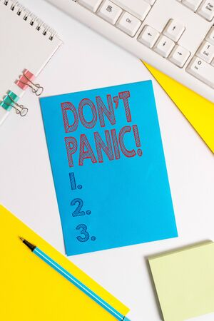 Conceptual hand writing showing Don T Panic. Concept meaning suddenly feel so worried or frightened that you can not behave Colored paper binder clip sheets white desk empty space Stock fotó