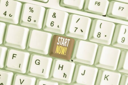 Word writing text Start Now. Business photo showcasing do not hesitate get working or doing stuff right away White pc keyboard with empty note paper above white background key copy space