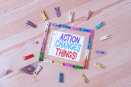 Handwriting text writing Action Changes Things. Conceptual photo start doing something against problem resolve or achieve it Colored clothespin papers empty reminder wooden floor background office