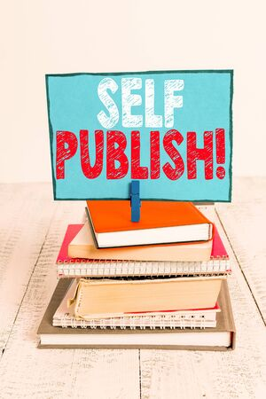 Writing note showing Self Publish. Business concept for writer publish piece of ones work independently at own expense pile stacked books notebook pin color reminder white wooden