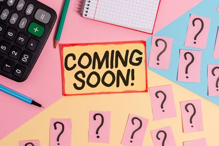 Text sign showing Coming Soon. Business photo text event or action that will happen after really short time Mathematics stuff and writing equipment above pastel colours background Reklamní fotografie