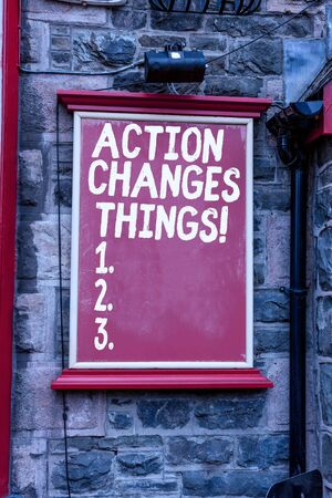 Conceptual hand writing showing Action Changes Things. Concept meaning start doing something against problem resolve or achieve it Blank board copy space for commercial advertising on wall