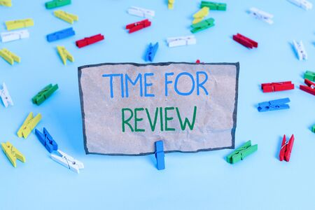Handwriting text writing Time For Review. Conceptual photo review of a system or situation in its formal examination Colored clothespin papers empty reminder blue floor background office pin 写真素材