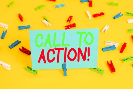 Writing note showing Call To Action. Business concept for exhortation do something in order achieve aim with problem Colored clothespin papers empty reminder yellow floor background office