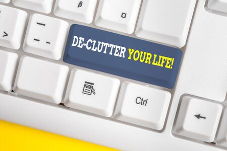 Word writing text De Clutter Your Life. Business photo showcasing remove unnecessary items from untidy or overcrowded places White pc keyboard with empty note paper above white background key copy space