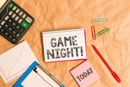Writing note showing Game Night. Business concept for usually its called on adult play dates like poker with friends Papercraft desk square spiral notebook office study supplies