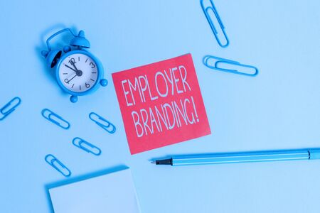 Conceptual hand writing showing Employer Branding. Concept meaning promoting company employer choice to desired target group Alarm clock notepad sticky note marker colored background Reklamní fotografie - 130032344