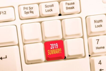 Conceptual hand writing showing 2019 Summary. Concept meaning summarizing past year events main actions or good shows White pc keyboard with note paper above the white background
