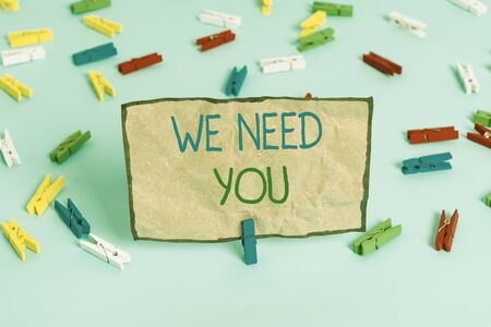 Handwriting text writing We Need You. Conceptual photo to fulfill the needs of the assignment duty or obligation Colored clothespin papers empty reminder blue floor background office pin