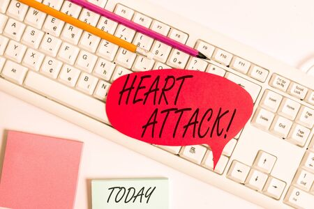 Word writing text Heart Attack. Business photo showcasing sudden occurrence of coronary thrombosis resulting in death Empty copy space red note paper bubble above pc keyboard for text message