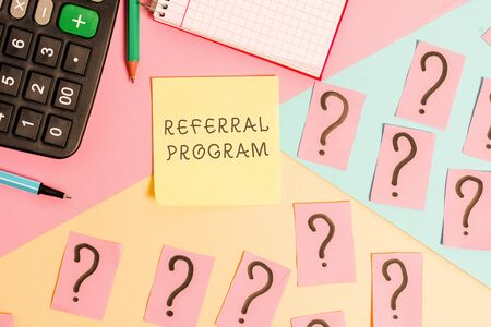 Conceptual hand writing showing Referral Program. Concept meaning employees are rewarded for introducing suitable recruits Mathematics stuff and writing equipment on pastel background