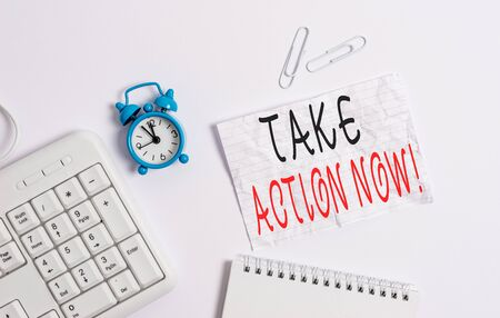 Writing note showing Take Action Now. Business concept for do something official or concerted achieve aim with problem Blank paper with copy space on the table with clock and pc keyboard 写真素材